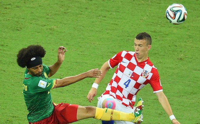 Cameroon's defender Benoit Assou Ekotto (L) vies for the ball with Croatia's midfielder Ivan Perisic, during a Group A football match between Cameroon and Croatia in the Amazonia Arena in Manaus during the 2014 FIFA World Cup on June 18, 2014. (EMMANUEL DUNAND/AFP/Getty Images)
