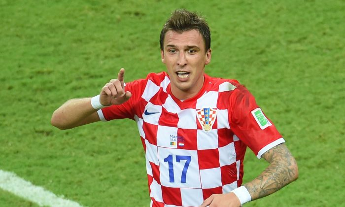 Croatia's forward Mario Mandzukic celebrates his goal during a Group A football match between Cameroon and Croatia in the Amazonia Arena in Manaus during the 2014 FIFA World Cup on June 18, 2014. (EMMANUEL DUNAND/AFP/Getty Images)