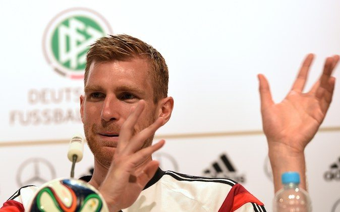 Germany's defender Per Mertesacker gestures during a press conference in Santo Andre on June 19, 2014 as part of the FIFA 2014 World Cup in Brazil. (PATRIK STOLLARZ/AFP/Getty Images)