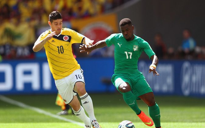 James Rodriguez of Colombia controls the ball against Serge Aurier of the Ivory Coast during the 2014 FIFA World Cup Brazil Group C match between Colombia and Cote D'Ivoire at Estadio Nacional on June 19, 2014 in Brasilia, Brazil. (Warren Little/Getty Images)