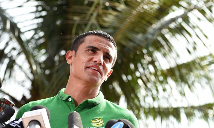 Australia's forward Tim Cahill speaks to the media in Vitoria, on June 19, 2014, the day after their 2014 FIFA World Cup Group B football match against Netherlands. (WILLIAM WEST/AFP/Getty Images)