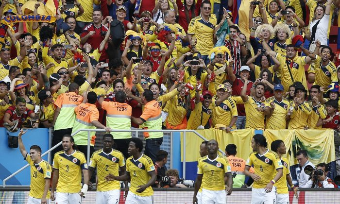 Colombia's midfielder Juan Fernando Quintero (L) celebrates scoring with teammates during a Group C football match between Colombia and Ivory Coast at the Mane Garrincha National Stadium in Brasilia during the 2014 FIFA World Cup on June 19, 2014. (ADRIAN DENNIS/AFP/Getty Images)