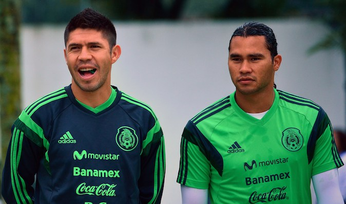 Mexico's forward Oribe Peralta (L) and midfielder Carlos Pena take part in a training session at the Rei Pele Training Center in Santos, Sao Paulo, on June 20, 2014 during the 2014 FIFA World Cup in Brazil. (YURI CORTEZ/AFP/Getty Images)