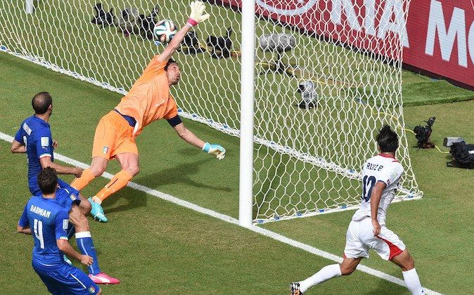 Costa Rica's forward Bryan Ruiz (R) scores against Italy's goalkeeper Gianluigi Buffon (2nd R) during a Group D football match between Italy and Costa Rica at the Pernambuco Arena in Recife during the 2014 FIFA World Cup on June 20, 2014. (JAVIER SORIANO/AFP/Getty Images)