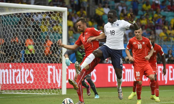 Switzerland's forward Haris Seferovic (L) vies with France's midfielder Moussa Sissoko (R) during a Group E football match between Switzerland and France at the Fonte Nova Arena in Salvador during the 2014 FIFA World Cup on June 20, 2014. (ODD ANDERSEN/AFP/Getty Images)