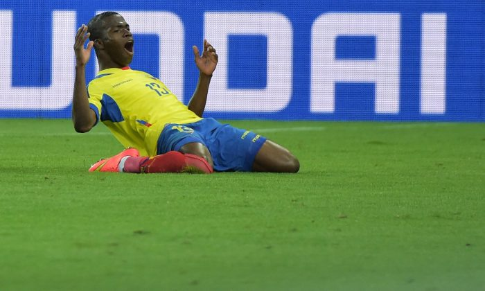 Ecuador's forward Enner Valencia celebrates after scoring a second goal during a Group E football match between Honduras and Ecuador at the Baixada Arena in Curitiba during the 2014 FIFA World Cup on June 20, 2014. (GABRIEL BOUYS/AFP/Getty Images)