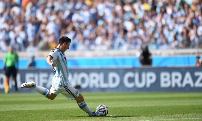 Argentina's forward and captain Lionel Messi takes a shot during the Group F football match between Argentina and Iran at the Mineirao Stadium in Belo Horizonte during the 2014 FIFA World Cup in Brazil on June 21, 2014. (BEHROUZ MEHRI/AFP/Getty Images)