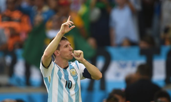 Argentina's forward and captain Lionel Messi celebrates after scoring a goal during their Group F football match against Iran at the Mineirao Stadium in Belo Horizonte during the 2014 FIFA World Cup in Brazil on June 21, 2014. (AFP/Getty Images)
