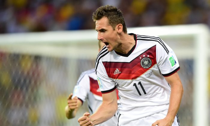 Germany's forward Miroslav Klose celebrates after scoring during a Group G football match between Germany and Ghana at the Castelao Stadium in Fortaleza during the 2014 FIFA World Cup on June 21, 2014. (JAVIER SORIANO/AFP/Getty Images)