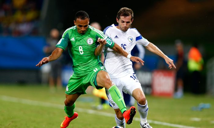 Peter Odemwingie of Nigeria competes for the ball with Senad Lulic of Bosnia and Herzegovina during the 2014 FIFA World Cup Group F match between Nigeria and Bosnia-Herzegovina at Arena Pantanal on June 21, 2014 in Cuiaba, Brazil. (Photo by Phil Walter/Getty Images)