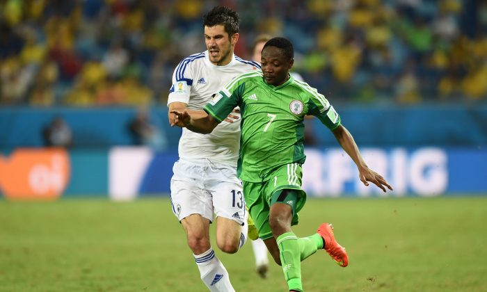 Nigeria's forward Ahmed Musa (R) challenges Bosnia-Hercegovina's midfielder Mensur Mujdza during the Group F football match between Nigeria and Bosnia-Hercegovina at the Pantanal Arena in Cuiaba during the 2014 FIFA World Cup on June 21, 2014. (JEWEL SAMAD/AFP/Getty Images)
