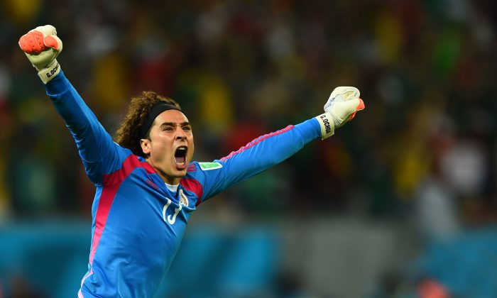 Guillermo Ochoa of Mexico celebrates his team's first goal during the 2014 FIFA World Cup Brazil Group A match between Croatia and Mexico at Arena Pernambuco on June 23, 2014 in Recife, Brazil. (Photo by Jamie McDonald/Getty Images)