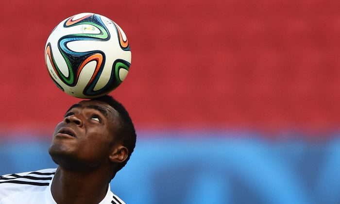 Nigeria's forward Emmanuel Emenike balances a ball on his head during a training session at the Beira-Rio Stadium in Porto Alegre on June 24, 2014 on the eve of a Group F football match against Argentina during the 2014 FIFA World Cup. (JEWEL SAMAD/AFP/Getty Images)