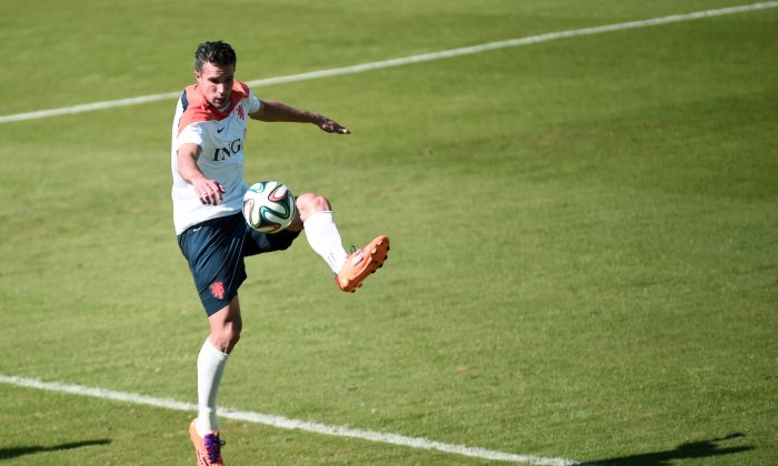 Netherlands' forward Robin van Persie takes part in a training session at the Flamengo Stadium in Rio de Janeiro on June 24, 2014 during the 2014 FIFA Football World Cup in Brazil. (DAMIEN MEYER/AFP/Getty Images)