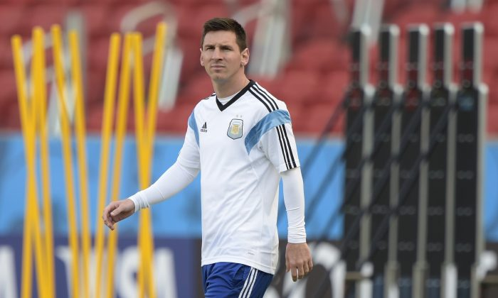 Argentina's forward Lionel Messi walks on the pitch during a team training session at Beira-Rio Stadium in Porto Alegre, some 1550 Km south-west of Rio de Janeiro on June 24, 2014 ahead of their 2014 FIFA World Cup Brazil Group F football match against Nigeria on June 25. (JUAN MABROMATA/AFP/Getty Images)