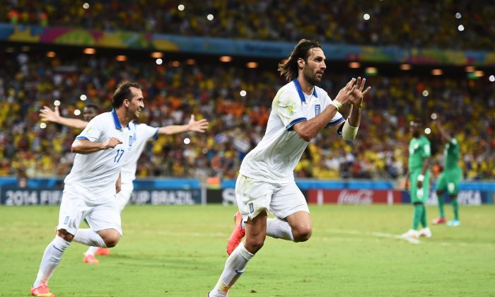 Giorgos Samaras of Greece celebrates scoring his team's second goal on a penalty kick during the 2014 FIFA World Cup Brazil Group C match between Greece and the Ivory Coast at Castelao on June 24, 2014 in Fortaleza, Brazil. (Photo by Laurence Griffiths/Getty Images)