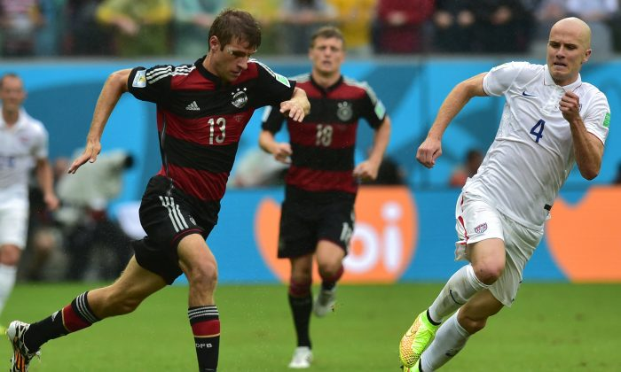 Germany's forward Thomas Mueller (L) and US midfielder Michael Bradley vie for the ball during a Group G football match between US and Germany at the Pernambuco Arena in Recife during the 2014 FIFA World Cup on June 26, 2014. (NELSON ALMEIDA/AFP/Getty Images)