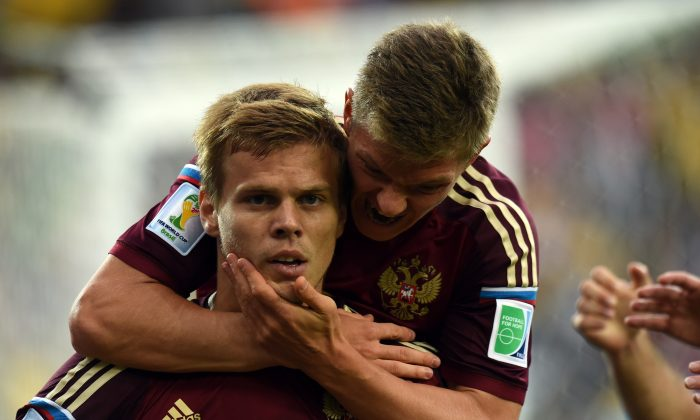 Russia's forward Alexander Kokorin (L) is embraced by Russia's midfielder Oleg Shatov after scoring during the Group H football match between Algeria and Russia at The Baixada Arena in Curitiba on June 26, 2014, during the 2014 FIFA World Cup. (PHILIPPE DESMAZES/AFP/Getty Images)