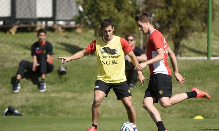 Belgium's midfielder Eden Hazard (L) and midfielder Adnan Januzaj challenge for the ball as they attend a training session in Mogi das Cruzes on June 27, 2014, during the 2014 FIFA World Cup. (MARTIN BUREAU/AFP/Getty Images)