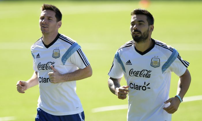 Argentina's forward Lionel Messi (L) and forward Ezequiel Lavezzi jog during a training session at 'Cidade do Galo', the Argentinean team's base camp in Vespasiano, near Belo Horizonte, on June 28, 2014 during the 2014 FIFA Football World Cup in Brazil. (JUAN MABROMATA/AFP/Getty Images)