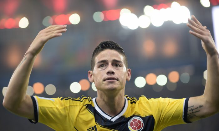 Colombia's midfielder James Rodriguez celebrates after scoring during the Round of 16 football match between Colombia and Uruguay at the Maracana Stadium in Rio de Janeiro during the 2014 FIFA World Cup on June 28, 2014. (DANIEL GARCIA/AFP/Getty Images)
