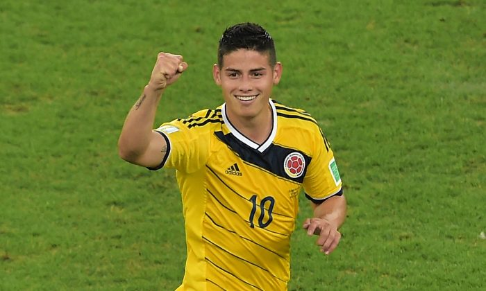 Colombia's midfielder James Rodriguez celebrates scoring the 2-0 goal during the Round of 16 football match between Colombia and Uruguay at the Maracana Stadium in Rio de Janeiro during the 2014 FIFA World Cup in Brazil on June 28, 2014. (GABRIEL BOUYS/AFP/Getty Images)