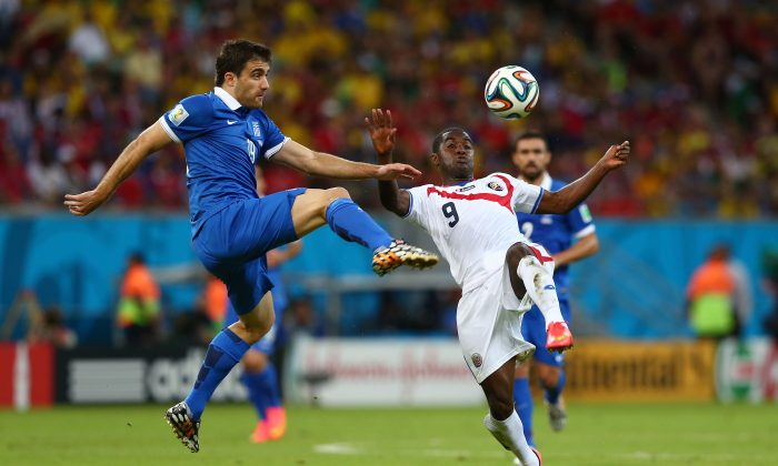 Sokratis Papastathopoulos of Greece challenges Joel Campbell of Costa Rica during the 2014 FIFA World Cup Brazil Round of 16 match between Costa Rica and Greece at Arena Pernambuco on June 29, 2014 in Recife, Brazil. (Quinn Rooney/Getty Images)