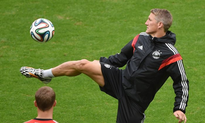 Germany's midfielder Bastian Schweinsteiger warms up warms up during a training session in the Beira-Rio Stadium in Porto Alegre on June 29, 2014 on the eve of their Round of 16 football match between Germany and Algeria during the 2014 FIFA World Cup. (PATRIK STOLLARZ/AFP/Getty Images)