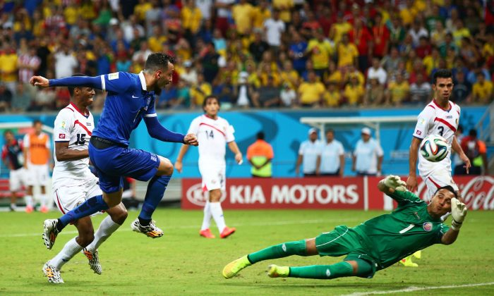Konstantinos Mitroglou of Greece has his shot saved by Keylor Navas of Costa Rica in extra time during the 2014 FIFA World Cup Brazil Round of 16 match between Costa Rica and Greece at Arena Pernambuco on June 29, 2014 in Recife, Brazil. (Photo by Ian Walton/Getty Images)