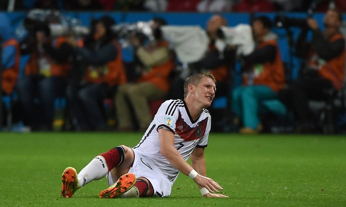 Germany's midfielder Bastian Schweinsteiger reacts during a Round of 16 football match between Germany and Algeria at Beira-Rio Stadium in Porto Alegre during the 2014 FIFA World Cup on June 30, 2014. (PATRIK STOLLARZ/AFP/Getty Images)
