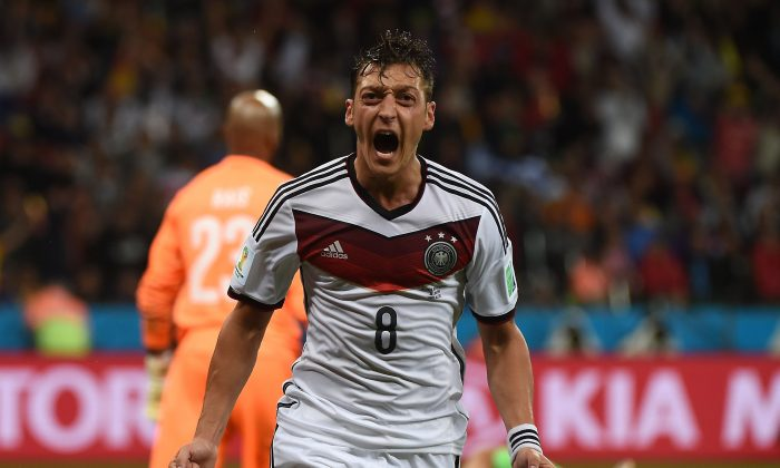 Germany's midfielder Mesut Ozil celebrates scoring during a Round of 16 football match between Germany and Algeria at Beira-Rio Stadium in Porto Alegre during the 2014 FIFA World Cup on June 30, 2014. (PATRIK STOLLARZ/AFP/Getty Images)