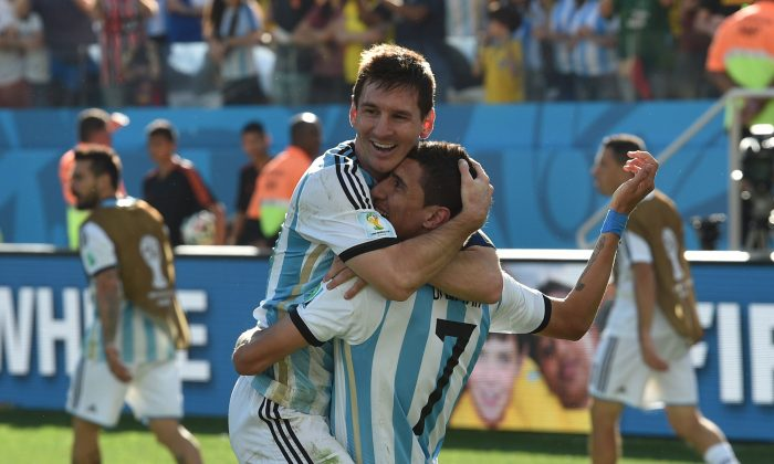 Argentina's forward and captain Lionel Messi (L) and Argentina's midfielder Angel Di Maria celebrate after scoring the 1-0 during a Round of 16 football match between Argentina and Switzerland at Corinthians Arena in Sao Paulo during the 2014 FIFA World Cup on July 1, 2014. (NELSON ALMEIDA/AFP/Getty Images)