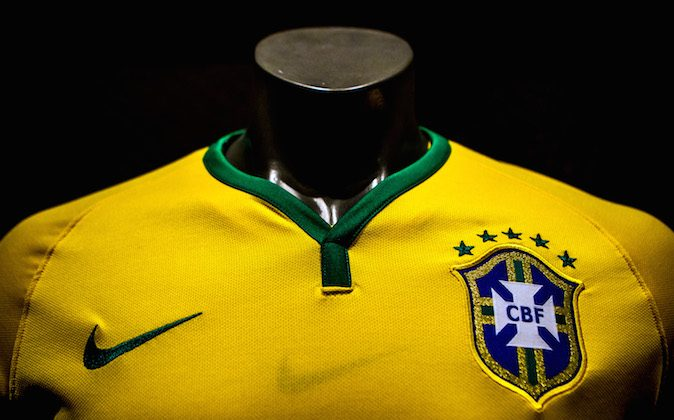 Brazil's football team jersey for the 2014 FIFA World Cup is unveiled on November 24, 2013 in Rio de Janeiro, Brazil. (Photo by Buda Mendes/Getty Images)