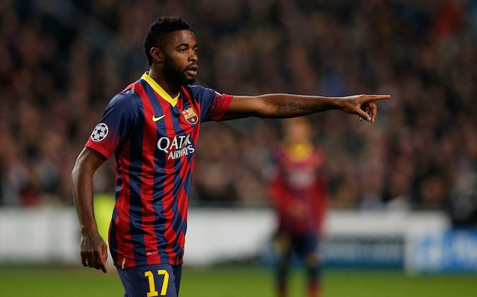 Alex Song of Barcelona speaks to a team mate during the UEFA Champions League Group H match between Ajax Amsterdam and FC Barcelona at Amsterdam Arena on November 26, 2013 in Amsterdam, Netherlands. (Dean Mouhtaropoulos/Getty Images)