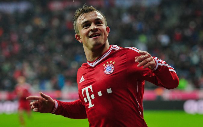 Xherdan Shaqiri of Muenchen celebrates his team's third goal during the Bundesliga match between FC Bayern Muenchen and Hamburger SV at Allianz Arena on December 14, 2013 in Munich, Germany. (Lennart Preiss/Bongarts/Getty Images)
