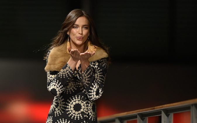 Russian model Irina Shayk blows a kiss as she presents a creation by Desigual during the 080 Barcelona Autumn-Winter 2014-2015 fashion week in Barcelona on January 28, 2014. (LLUIS GENE/AFP/Getty Images)