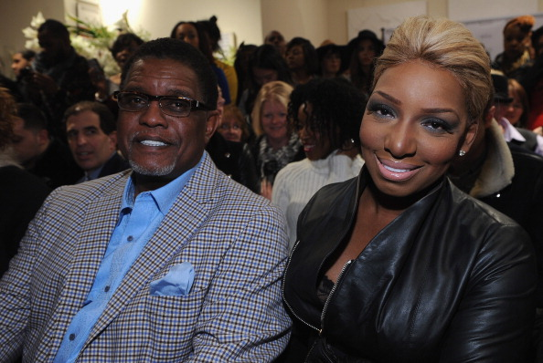 Reality stars Gregg and NeNe Leakes (R) attend the Michael Costello fashion show at Helen Mills Event Space on February 8, 2014 in New York City. (Photo by Fernando Leon/Getty Images)