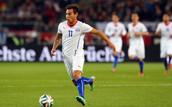Eduardo Vargas of Chile runs with the ball during the International Friendly Match between Germany and Chile at Mercedes-Benz Arena on March 5, 2014 in Stuttgart, Germany. (Photo by Martin Rose/Bongarts/Getty Images)