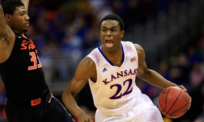 Andrew Wiggins #22 of the Kansas Jayhawks drives upcourt as Marcus Smart #33 of the Oklahoma State Cowboys defends during the Big 12 Basketball Tournament quarterfinal game at Sprint Center on March 13, 2014 in Kansas City, Missouri. (Jamie Squire/Getty Images)