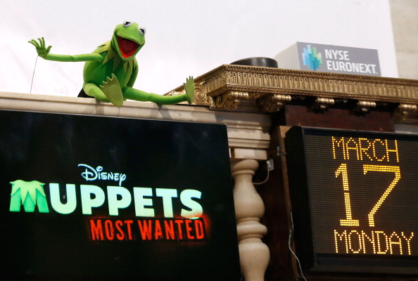 Muppets character Kermit the Frog poses for a photo after ringing the opening bell at the New York Stock Exchange on March 17, 2014 in New York City. (Photo by Jemal Countess/Getty Images)