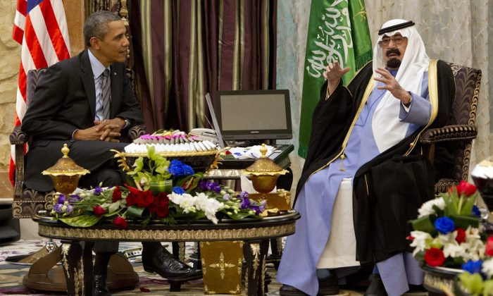 US President Barack Obama (L) meets with Saudi King Abdullah (R) at Rawdat Khurayim, the monarch's desert camp 60 KM (35 miles) northeast of Riyadh, on March 28, 2014. Obama arrived in Riyadh for talks with Saudi King Abdullah as mistrust fuelled by differences over Iran and Syria overshadows a decades-long alliance between their countries. (Saul Loeb/AFP/Getty Images)