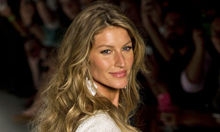 Brazilian supermodel Gisele Bundchen presents a creation by Colcci during the 2015 Summer collections of the Sao Paulo Fashion Week in Sao Paulo, Brazil, on April 2, 2014. (AFP ALMEIDA/AFP/Getty Images)
