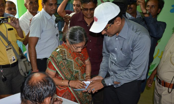 Jashodaben Modi, wife of Gujarat Chief Minister and Bhartiya Janta Party (BJP) Prime ministeral Candidate Narendra Modi (C) arrives to cast her vote in a polling centre at Unjha town, some 100 kms from Ahmedabad on April 30, 2014. (STR/AFP/Getty Images)