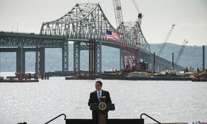 New York Governor Andrew Cuomo at the Washington Irving Boat Club with the Tappan Zee Bridge in the background, Tarrytown, NY, May 14. (Andrew Burton/Getty Images)
