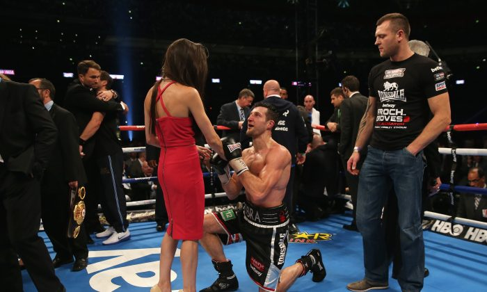 Carl Froch of England celebrates his victory against George Groves of England at Wembley Stadium on May 31, 2014 in London, England by proposing to his girlfriend. (Scott Heavey/Getty Images)