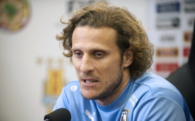 Uruguay's football team player Diego Forlan speaks during a press conference held at the Complejo Celeste training complex in Canelones, Uruguay, on June 2, 2014. (MIGUEL ROJO/AFP/Getty Images)