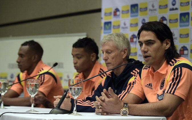 Colombia's national forward Radamel Falcao Garcia (R) speaks next to team coach Jose Pekerman (2-R), and teammates Amaranto Perea (L) and Luis Muriel during a press conference to announce that all three of them will be out of the list of 23 players for the FIFA World Cup, in Cardales, on June 2, 2014. (DANIEL GARCIA/AFP/Getty Images)
