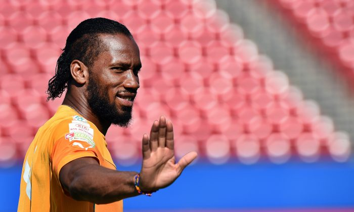 Ivory Coast's forward Didier Drogba arrives for a training session at the Toyota Stadium in Frisco, Texas, on June 3, 2014, on the eve of their World Cup preparation match against El Salvador. The west Africans have been drawn in Group C along with Colombia, Greece and Japan for World Cup 2014 and kick off their campaign in Recife, Brazil, on June 14 against the Japanese. (JEWEL SAMAD/AFP/Getty Images)