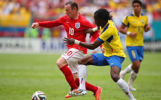 Wayne Rooney of England and Juan Carlos Paredes of Ecuador battle for the ball during the International friendly match between England and Ecuador at Sun Life Stadium on June 4, 2014 in Miami Gardens, Florida. (Photo by Richard Heathcote/Getty Images)