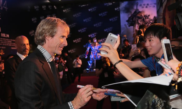 BEIJING, CHINA - JUNE 23: Director Michael Bay arrives the red carpet for Beijing premiere screening of 'Transformers: Age of Extinction' at Wanda CBD cinema on June 23, 2014 in Beijing, China. (Photo by Lucian Capellaro/Paramount Pictures)